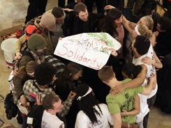 Protesters celebrate inside of the state Capitol in Madison, Wis., Thursday after a judge ordered the Department of Administration to open the Capitol to normal business hours starting Monday.