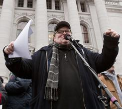 Michael Moore addresses a crowd Saturday at the state Capitol in Madison, Wis.