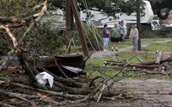 Residents look at damage from a suspected tornado Saturday in Rayne, La.