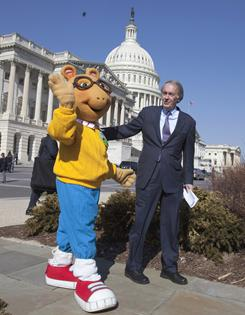 PBS' Arthur the Aardvark walks with Rep. Ed Markey on Feb. 16 to a news conference about the future of public broadcasting.