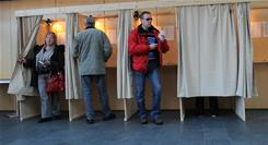 Estonians prepare to cast their vote for the general election at a polling station in Tallinn on Sunday.