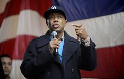 Entertainment promoter Russell Simmons addresses Sunday's rally in New York. The rally opposes a planned hearing on homegrown terrorism.