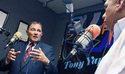 Utah Governor Gary Herbert talks immigration with Salt Lake City radio host Tony Yapias last July.