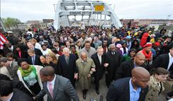 Congressmen Steny Hoyer, John Lewis and Harry Reid march arm-in-arm on the Edmund Pettus Bridge in Selma, Ala., on Sunday.