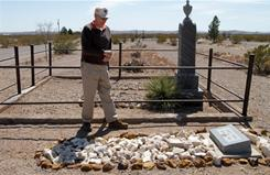 Historian Richard Dean at the grave site of his great-grandfather James T. Dean in Columbus, N.M. He was killed during Villa's raid 95 years ago.