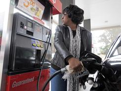 Marilyn Davis, 50, fills up her car at a QuikTrip gas station in Smyrna, Ga., on Thursday. She says she adjusted her driving habits to cope with rising fuel prices.