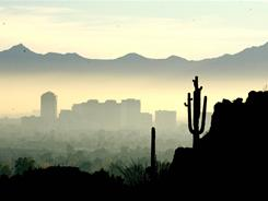 Smog and haze obscure the Phoenix skyline from Piestewa Peak.