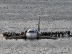 Passengers wait to be rescued on the wings of a US Airways Airbus 320 jetliner that ditched in the Hudson River in New York on Jan. 15, 2009.