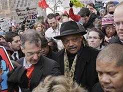 Wisconsin Rep. Joe Parisi, D-Madison, and Rev. Jesse Jackson make their way around the state Capitol in Madison on Thursday, in an attempt to get into the building.