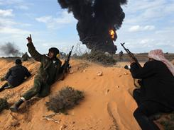 Libyan rebels fight government troops Wednesday near Ras Lanouf.