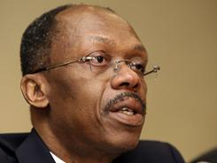 Former Haitian President Jean-Bertrand Aristide speaks during a news conference in Johannesburg, South Africa, in January, 2010.
