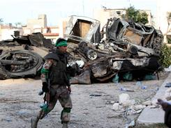 A soldier of Lybian leader Moammer Gadhafi's loyalist forces enters Zawiya, west of Tripoli, on Friday.