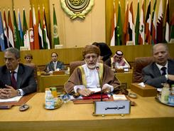 From left, Arab League chief Amr Moussa, Oman's Foreign Minister Yousuf bin Alawi and the Arab League's undersecretary general Ahmed bin Helli attend an emergency meeting in Cairo on Saturday.