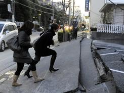 A pedestrian road collapsed in the massive 8.9-magnitude earthquake in Urayasu city, Chiba Prefecture, on Friday.