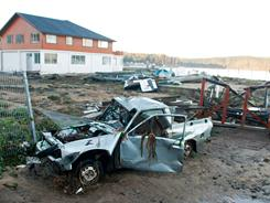 Picture of a destroyed car taken in Dichato, south of Santiago, on Saturday hours after the place was hit by tsunami waves from Japan's huge quake, causing some damage.