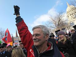 Democratic state Sen. Mark Miller marches around the Capitol with protesters Saturday in Madison, Wis.