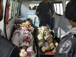 Afghan victims of a suicide attack on an Afghan army recruitment center are seen in a ambulance at the hospital in Kunduz.