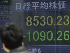 Japan's Nikkei stock index nose-dived Tuesday as the country faced a nuclear threat. Other Asian markets also tumbled.