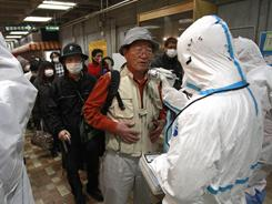 A man is screened for radiation exposure Tuesday in Koriyama city, Fukushima Prefecture.