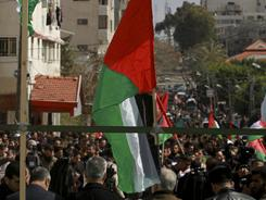 Palestinians attend a rally Friday calling for reconciliation between rival leading factions in Gaza City.