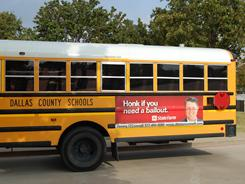 A State Farm ad adorns a Dallas County school bus. Six states, including Texas, allow ads on school buses.