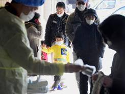 People are scanned for radiation exposure in Fukushima, Japan, on Friday, one week after a massive earthquake and tsunami.