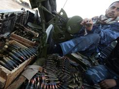 Libyan rebels carry ammunition in the eastern Libyan coastal town of Tobruk near the border with Egypt on Wednesday.