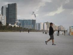 People dot the beach near the famed Ocean Drive strip on Jan. 28, 2009, in Miami Beach The state saw rapid growth during the first half of the decade, new Census data show.