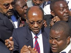 Former President Jean-Bertrand Aristide returns to Haiti, days before the country's presidential election.