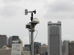 A RadNet radiation monitor sits on the roof of the Bay Area Air Quality District offices in San Francisco.