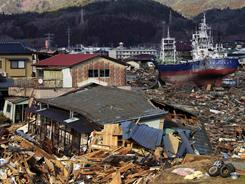 A large vessel stands amid debris Friday after being washed ashore by the tsunami in Kesennuma, Japan.