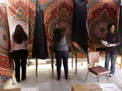 Egyptian women vote at a polling station Saturday in Cairo on a referendum on constitutional amendments.