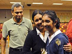 Tapas Mishra, left, and Sasmita Mishra join daughter Stuti Mishra, who won the Brevard County Spelling Bee for grades 4-8 on Feb. 23.