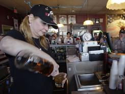 "Bartender Charlena ""Charley"" Wolfe pours a drink Feb. 10 at VFW Post 4044 in Columbus, Ohio."