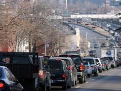 A recent study finds that people drive less in compact cities that have extensive transportation systems.