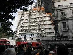 Flames engulf part of the Interior Ministry complex in Cairo on Tuesday. The fire followed a protest by police officers calling for better wages and working conditions.
