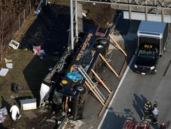 Emergency crews respond to a bus crash on Interstate 95 in New York City's Bronx borough on March 12. Fifteen people died in the crash.