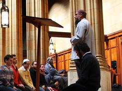 Imam Omer Bajwa addresses a group at Dwight Hall Chapel at Yale University. He sees more colleges hiring Muslim chaplains.
