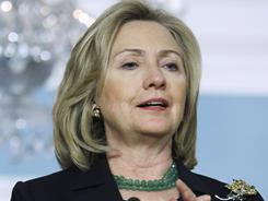Secretary of State Hillary Rodham Clinton says Gadhafi  and his closest advisers have decisions to make as coalition forces launched a fifth day of air strikes against military targets in the North African country.