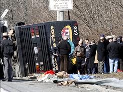 The scene of a bus crash on Interstate-95 in the Bronx on March 12, 2011. At least 13 people died when the bus flipped onto its side and was sliced in half by a sign pole.