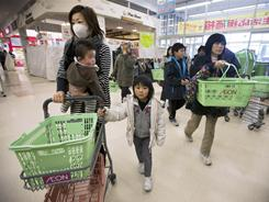As supplies dwindle, people shop for food in Ichinoseki, Japan. So far, radiation has seeped into water, raw milk, seawater and various kinds of vegetables.