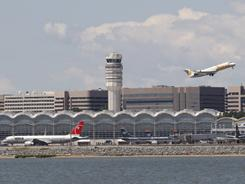 Pilots of two planes were unable to reach the air traffic controller Tuesday night at Washington's Reagan National Airport.