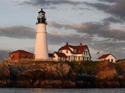 Portland Head Light historic lighthouse basks in the early morning sunlight in Cape Elizabeth, Maine.