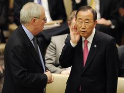 U.N. Secretary-General Ban Ki-Moon, right, listens to British U.N. Ambassador Sir Mark Justin Lyall Grant before a Security Council meeting on the situation in Libya, Thursday, March 24.