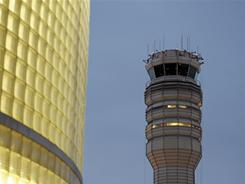 The FAA control tower at Reagan National Airport is seen in Arlington, Va., March 23.