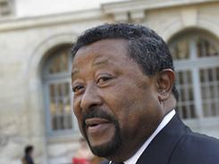 African Union chief Jean Ping calls for talks between Gadhafi's regime and rebels in an effort to solve conflict in Libya.