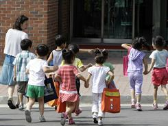 Children of North Korean defectors arrive at the Hanawon shelter. Most of their parents came to South Korea via third countries such as China.