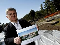 Bill Christopher with Urban Concepts holds an artist rendering of the main house where it would be built by Tower Lane Properties in Los Angeles.