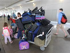The House bill would look at possibly requiring airlines to compensate fliers for bags that arrive late. Above, luggage at LAX airport.