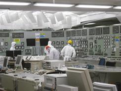 Lighting becomes available on Saturday in the control room of the Unit 2 reactor at the stricken Fukushima Dai-ichi nuclear plant in Japan.